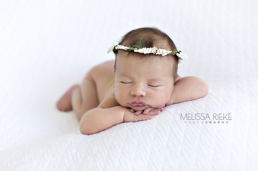 Newborn Baby Girl On White Halo Picture Studio